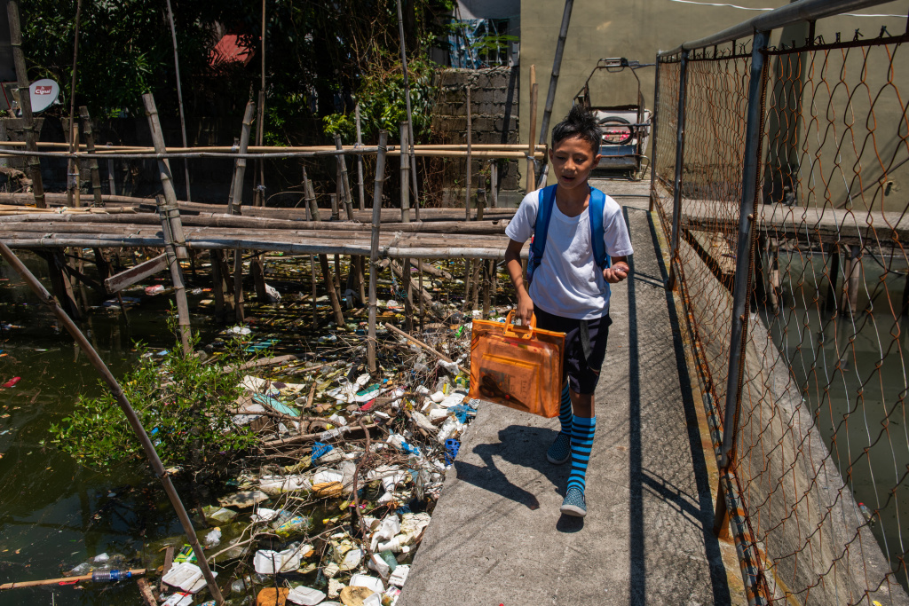 Around the globe, people are searching for ways to reduce plastic waste. Above: Dampalit, a fishing community in Manila Bay, can't keep up with a constant influx of trash.