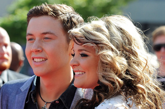 Finalists Scotty McCreery (L) and Lauren Alaina arrive at Fox's 'American Idol' season 10 finale results show held at Nokia Theatre LA Live on May 25, 2011 in Los Angeles, California.