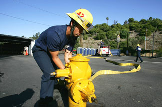 A firefighter recruit practices during training by the Los Angeles Fire Department at the Frank Hotchkin Memorial Training Center Los Angeles, California. File photo.