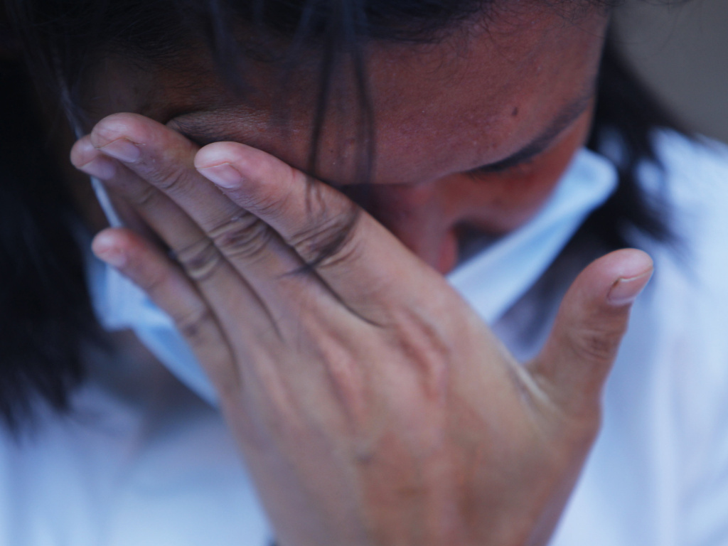 A Nepali woman cries as she participates in a candle light vigil for victims of last week's earthquake in Kathmandu, Nepal, on Saturday.