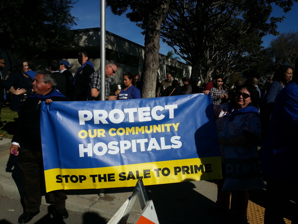 Members of SEIU-United Health Workers West opposed to the sale of the Daughters of Charity Hospitals to Prime Healthcare rally outside of a Jan. 2015 public hearing in Lynwood.