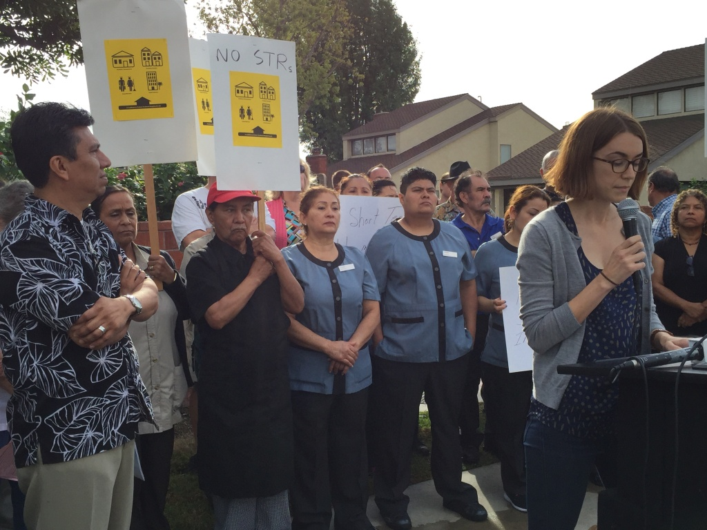 Hotel union workers attend a press conference Monday in a South Anaheim neighborhood organized by an Orange County community activist group petitioning Anaheim city officials to ban short-term rentals.