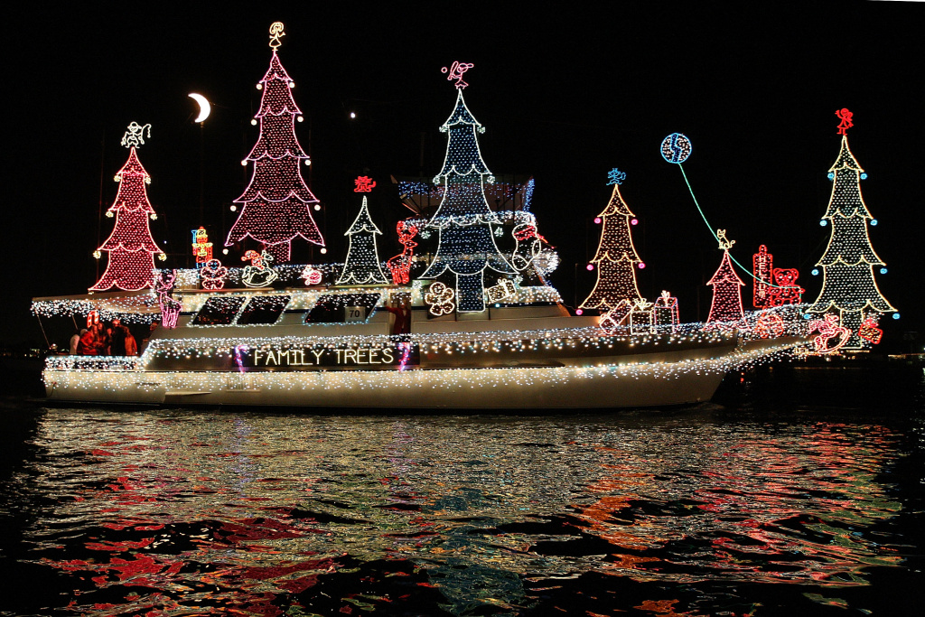 boats in the 101st annual newport beach christmas boat parade are lit with christmas decorations as