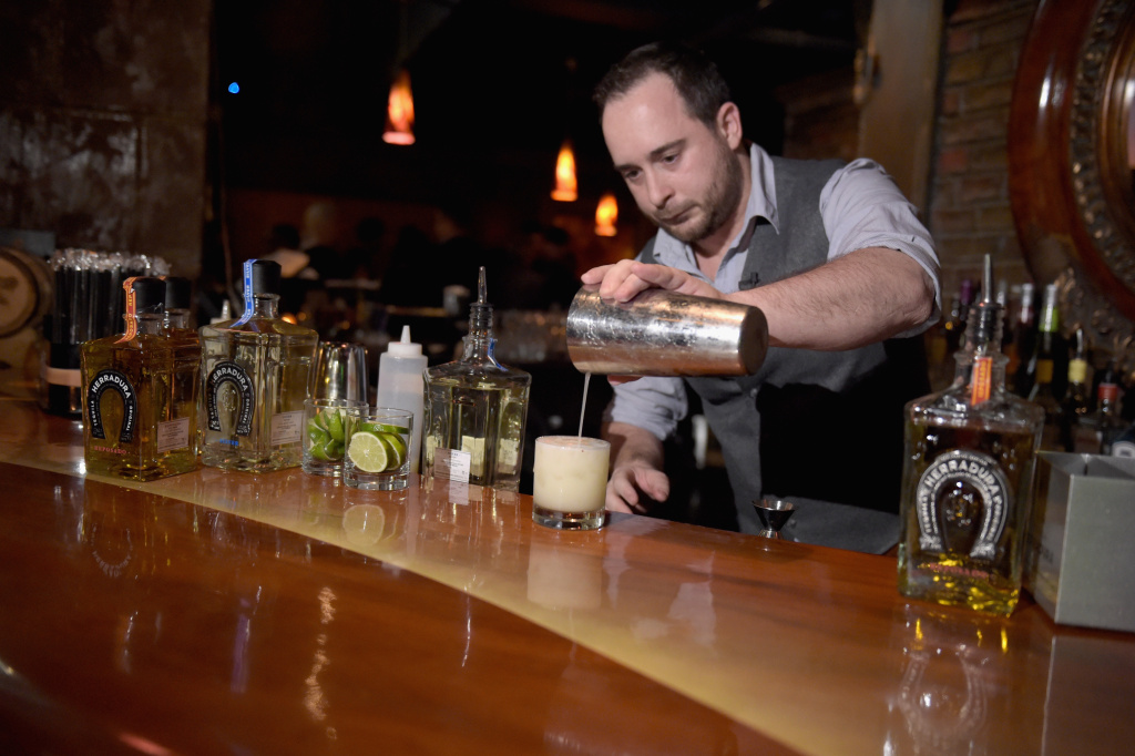 Mixologist Jimmy Fransioli prepares a Herradura cocktail at Tequila Herradura premieres 'Luck Is Earned' on National Margarita Day eve.