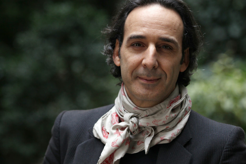 French film composer Alexandre Desplat poses outside a hotel in Paris. Born in 1961 from a Greek mother and a French father, Alexandre Desplat, composed the music for more than 50 European movies and Hollywood movies.