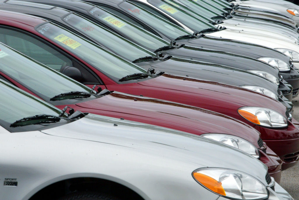 Orders placed with U.S. factories rose to a record high in June, boosted by strong demand for airplanes, machinery and autos. Factory orders rose 1.5 percent in June compared with May, the Commerce Department reported Friday. (File photo: Ford Taurus automobiles sit on the sales lot at World Ford in Pembroke Pines, Florida).