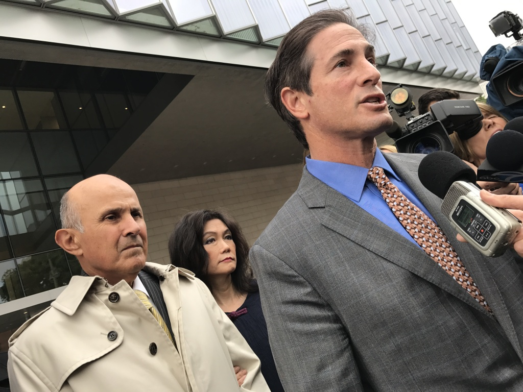 File: Former Sheriff Lee Baca stands behind his attorney Nathan Hochman on the steps of the federal courthouse. Baca has pleaded not guilty to charges of conspiracy, obstruction justice and lying.