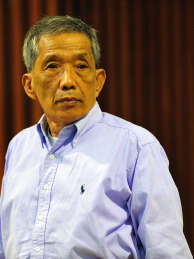 In this handout released by Extraordinary Chamber in the Courts of Cambodia (ECCC), Kaing Guek Eav, also known as 'Duch' stands in the courtroomin Phnom Penh province. The UN -backed Khmer Rouge tribunal convicted the former prison chief to 35 years for overseeing the torture and execution of more than 15,000 people at the notorious S-21 prison known as Tuol Sleng. Kaing Guek Eay, 67, will serve only 19 years of the sentence since he already spent 11 years awaiting the trial in detention.