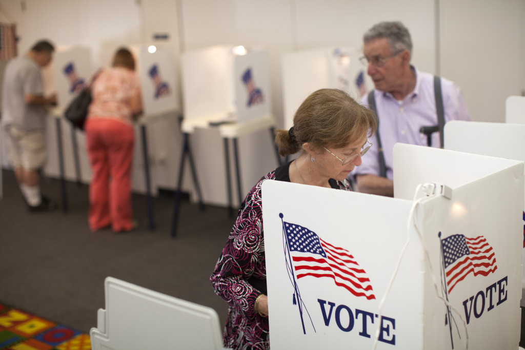 Evelyn Cederbaum and her husband, Stephen, right, cast their votes during the primary election at the Montana Branch Library in Santa Monica.