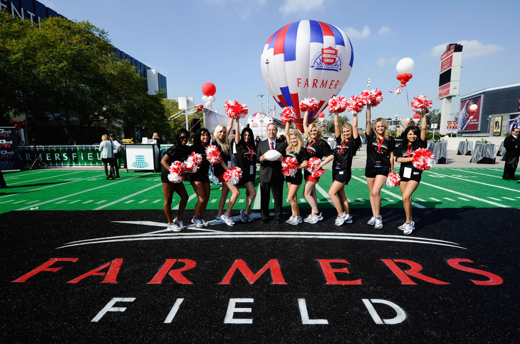 LOS ANGELES, CA - FEBRUARY 01:  Farmers Insurance Exchange executives Paul Patsis (C) with cheerleaders after an event announcing naming rights for the new football stadium Farmers Field at Los Angeles Convention Center on February 1, 2011 in Los Angeles, California. AEG has now dropped plans for the stadium.