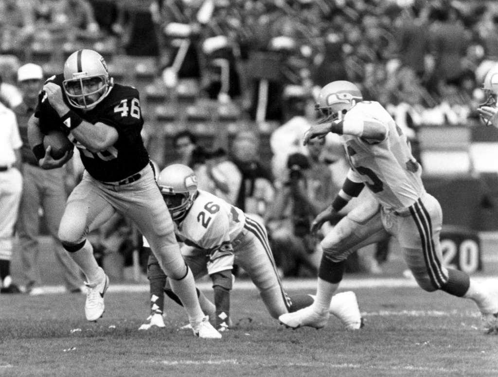 In this Oct. 30, 1983 photo provided by the NFL, Los Angeles Raiders tight end Todd Christensen (46) runs with the football after making a catch during a football game against the Seattle Seahawks in Los Angeles.