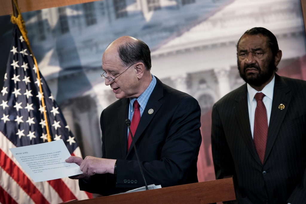 Rep. Brad Sherman (L), Democrat of California, and Rep. Al Green, Democrat of Texas, take questions about articles of impeachment for President Donald Trump during a press conference on Capitol Hill June 7, 2017 in Washington, D.C.