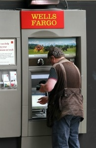 A banking customer uses an ATM at a Wells Fargo Bank branch on July 19, 2011 in Oakland, California.