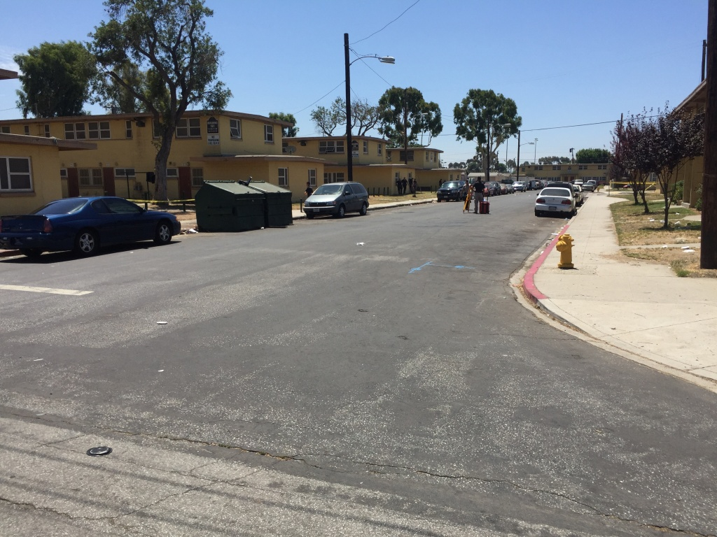 The shooting of a young black man by the LAPD Monday night occurred at the end of this street in the Nickerson Gardens Housing Project, one of the largest public housing projects in the country. Police say the man shot at them.