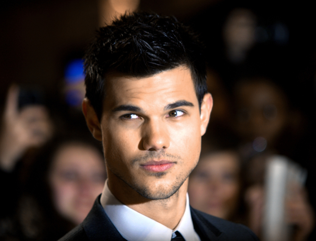 File: Taylor Lautner poses as he arrives for the premiere of 'Twilight: Breaking Dawn' in London's Stratford City on Nov. 16, 2011.