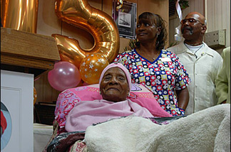 The world's oldest person, Gertrude Baines, naps amidst the media frenzy.