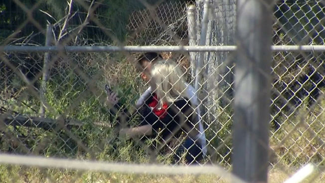 A man holds his ex-girlfriend hostage for more than two hours on the side of a Redlands street on March 24, 2016. The standoff with police ended with officers opening fire on the man and killing him.