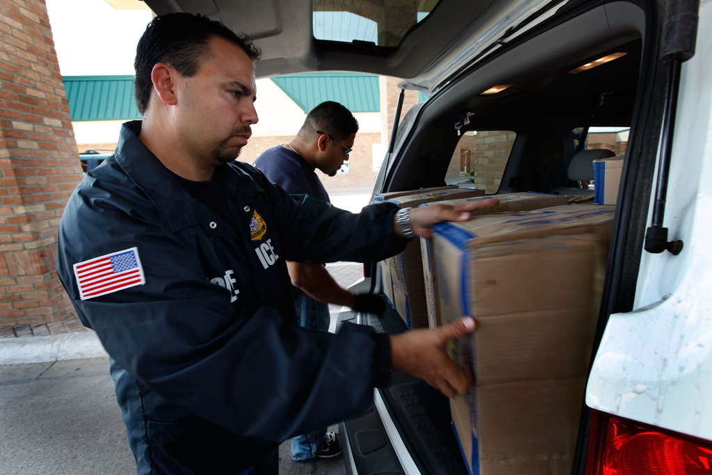 Special agents from Immigration and Customs Enforcement (ICE) search a vehicle heading into Mexico at the Hidalgo border crossing on May 28, 2010 in Hidalgo, Texas.