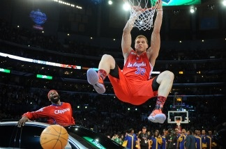 Blake Griffin from the L.A. Clippers slam dunks a ball over a car as teammate Baron Davis looks on, before winning the All-Stars Slam Dunk contest at the Staples Center in Los Angeles on Feb. 19, 2011.