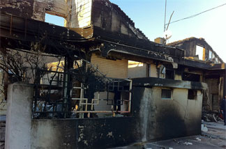Charred remains of houses on Yeonpyeong, two days after the island was subjected to a barrage of 170 artillery shells, fired by the North Korean army.
