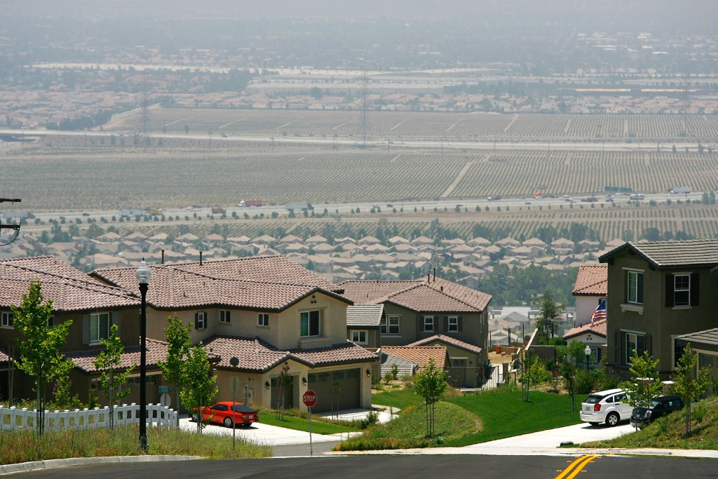 File: A new gated community housing project overlooks farms that are being rapidly converted into a vast suburb during a construction boom in San Bernardino County during World Population Day on July 11, 2007 near Rancho Cucamonga.