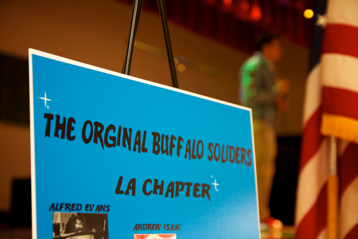 Several members of the Los Angeles chapter of the Buffalo Soldiers listen as program speakers honor them.
