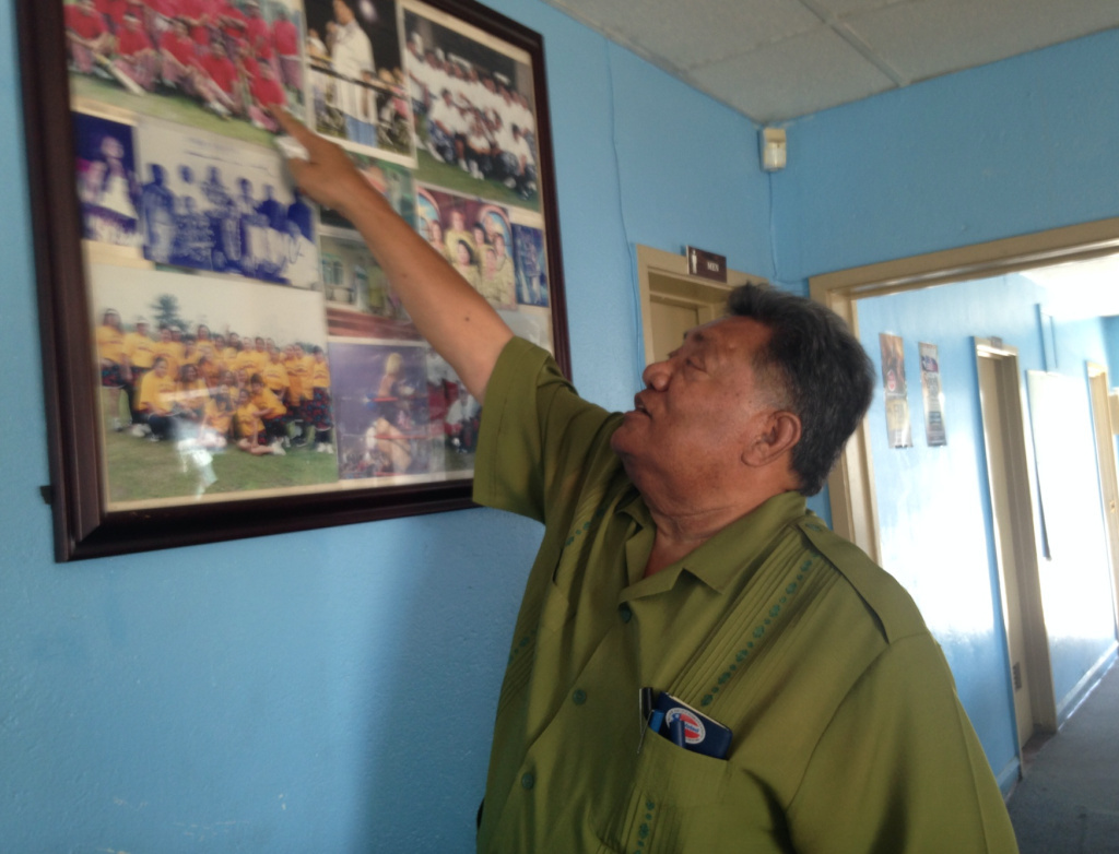 High Chief Loa Pele Faletogo of the Samoan Federation of America in Carson points to old photos from cricket games and other community events. He said sometimes he runs into people he hasn't seen for a while at an event and learns they have left the neighborhood.
