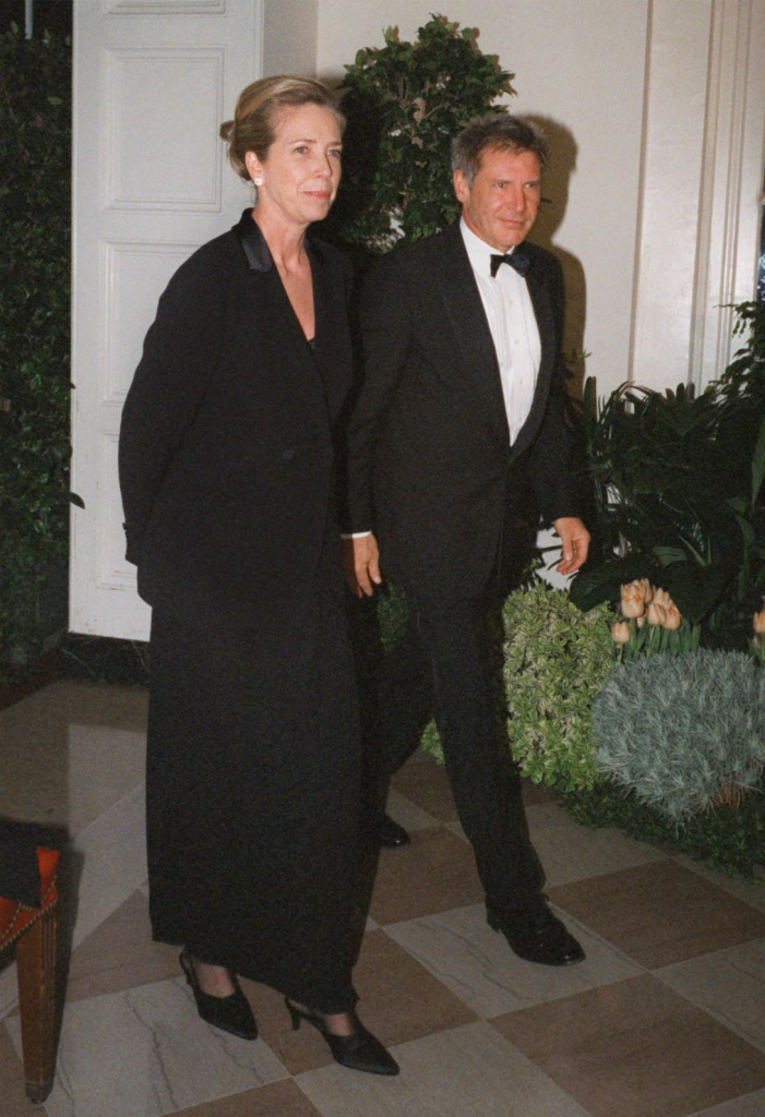 FILE - In this Feb. 5, 1998 file photo, Harrison Ford and his wife Melissa Mathison arrive at the White House for an official dinner for the British Prime Minister hosted by President Clinton in Washington. Mathison, the screenwriter who crafted the enchanting worlds of iconic family films including