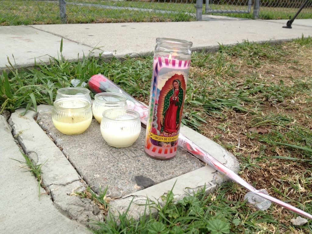 Candles are lit where a 14-year-old girl was shot last night in a Westmont neighborhood. Two suspects are at large.