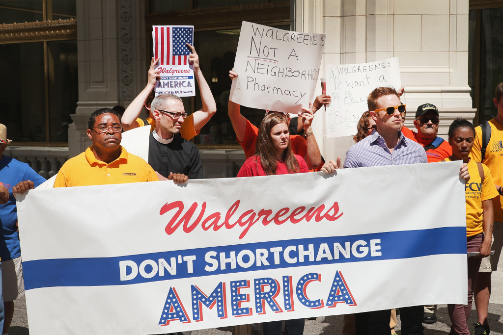 Demonstrators protest against the possibility of Walgreens moving their corporate headquarters overseas outside a Walgreens store on July 24, 2014 in Chicago, Illinois