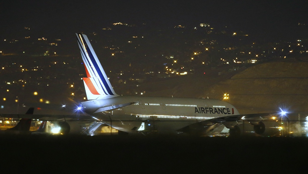Air France Airbus 380, Flight 65, sits on the runway at the Salt Lake City International Airport being inspected by the FBI on November 17, 2015. Two Air France flights bound for Paris from the United States were diverted and landed safely after the airline received anonymous bomb threats, the carrier said.