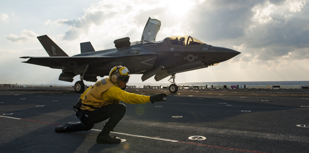 (Mar. 9, 2018) Aviation Boatswain's Mate 3rd Class Donovan Hampton launches an F-35B off the flight deck of the amphibious assault ship USS Wasp (LHD 1) as part of a routine patrol in the Indo-Pacific region.