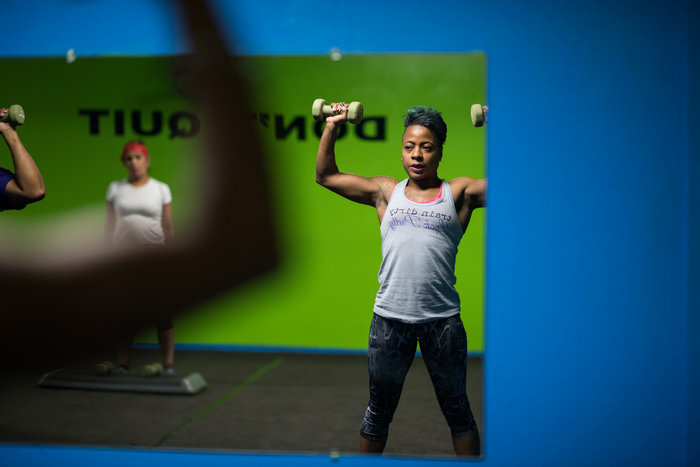 Samantha Pierce works out during a hip-hop aerobic class at Naturally Gifted Fitness Center in Cleveland Heights. Exercise is how she copes with the stresses in her life.