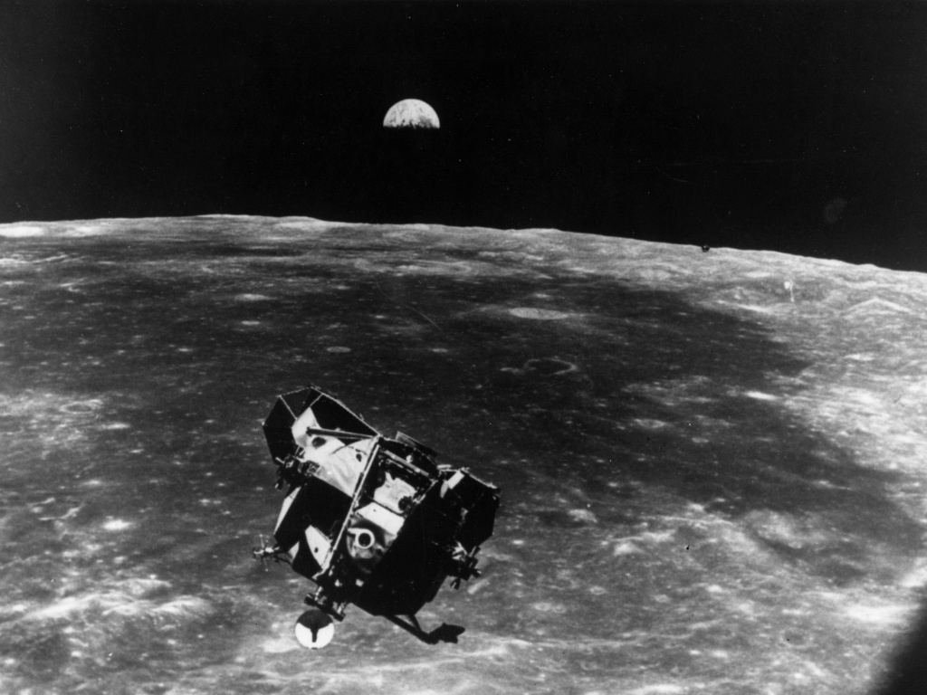 The Apollo 11 space module floating above the Moon.