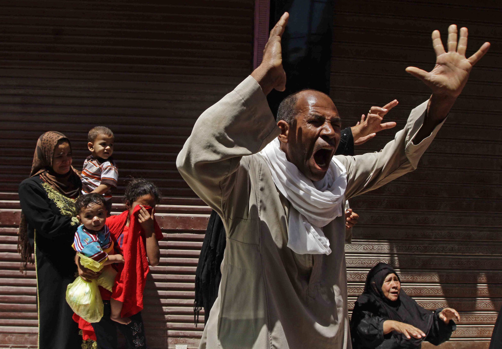 Relatives of a Muslim Brotherhood member who was sentenced to death react to the verdict outside a courtroom in Minya, Egypt, on Saturday.
