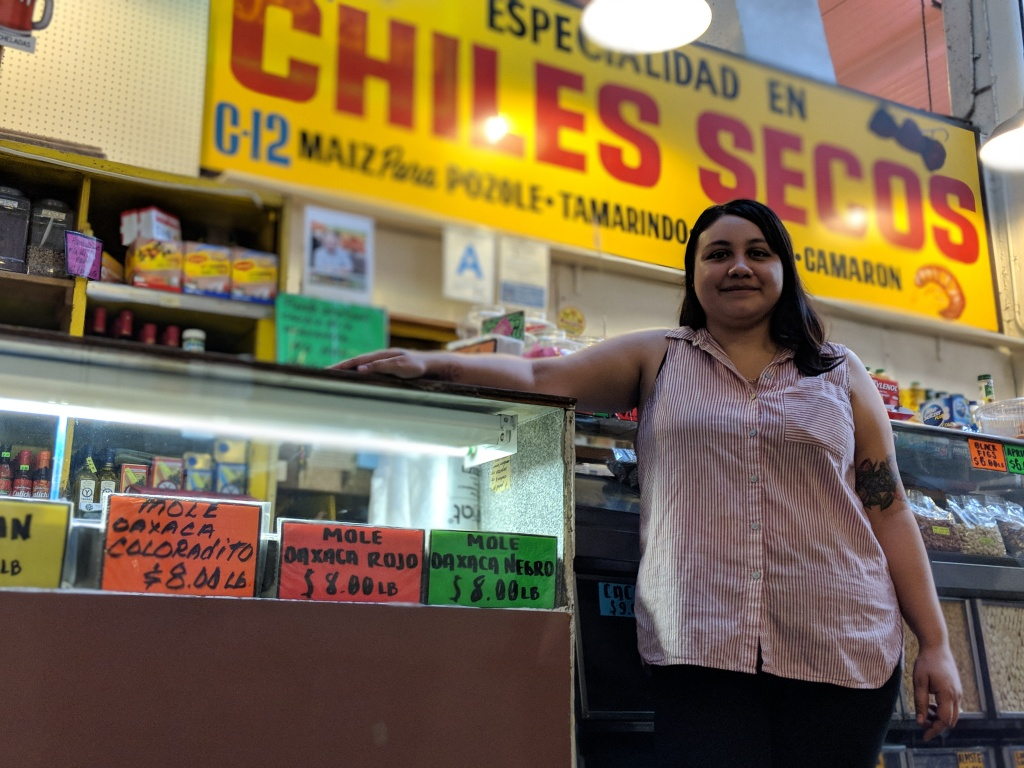 Claudia Armendariz stands in front of Chiles Secos, a stall at Grand Central Market that sells Latino groceries. Her grandfather opened the business in 1975.