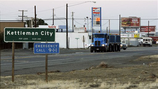 California Highway 41 is the main street of Kettleman City, Calif., seen Tuesday, Dec. 8, 2009. The tiny farm town is home to the largest toxic waste dump in the West. Chemical Waste Management, which wants to increase the size of one part of the dump and build another section. Pointing to an unusually high number of birth defects and infant deaths recently, area activists are asking Kings County to reject the expansion of the 1,600-acre facility.
