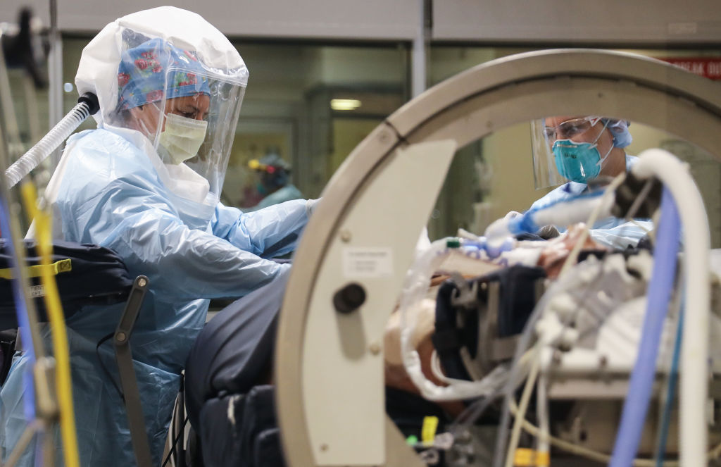Nurse  Kristyna Saja (L) and nurse Amanda Miller care for a COVID-19 patient in the Intensive Care Unit (ICU) at Sharp Grossmont Hospital amidst the coronavirus pandemic on May 5, 2020 in La Mesa, California.