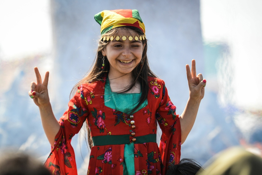 A girl flashes the victory sign as Turkish Kurds gather during Newroz celebrations in Diyarbakir, southeastern Turkey, on March 21, 2018. Also known as Nawroz or Nowruz, it is an ancient Persian festival, which is also celebrated by Kurdish people, marking the first day of spring.