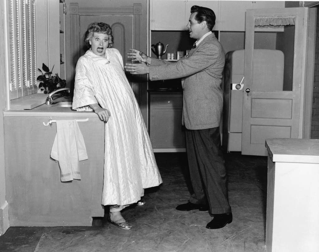 American actor Lucille Ball reacts to Cuban-born actor Desi Arnaz in a still from the television show, 'I Love Lucy', 1956.