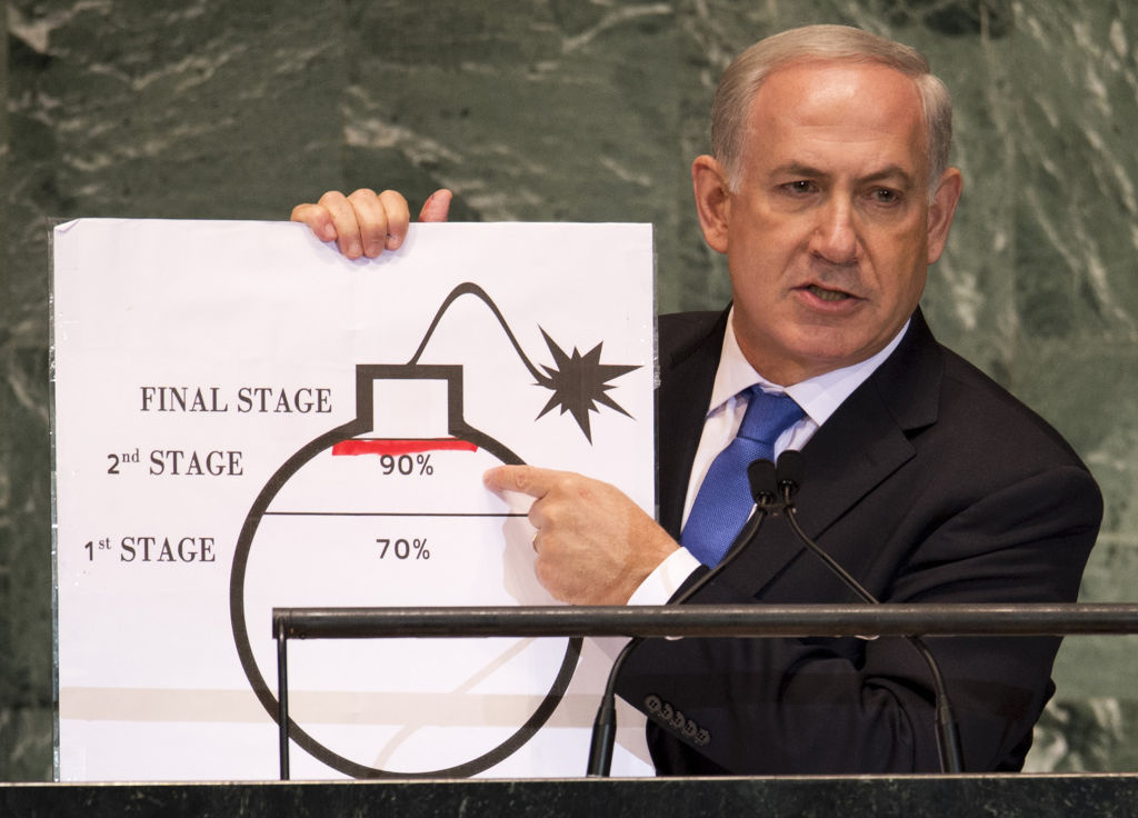 Benjamin Netanyahu, Prime Minister of Israel, uses a diagram of a bomb to describe Iran's nuclear program while delivering his address to the United Nations in September 2012.  The Obama administration is pushing for diplomacy to solve the impasse over Iran's nuclear program but has not ruled out the possibility of military intervention in Iran to prevent it from acquiring an atomic weapon.