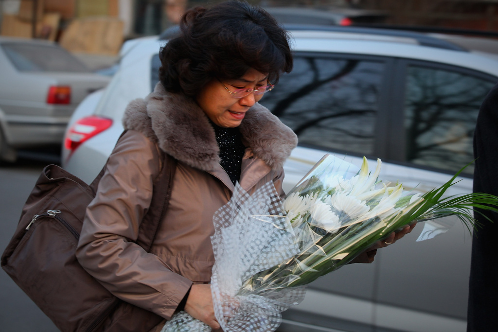 A North Korean woman cries as she arrives at the North Korea embassy to mourn the death of North Korean leader Kim Jong Il on December 19, 2011 in Beijing, China.