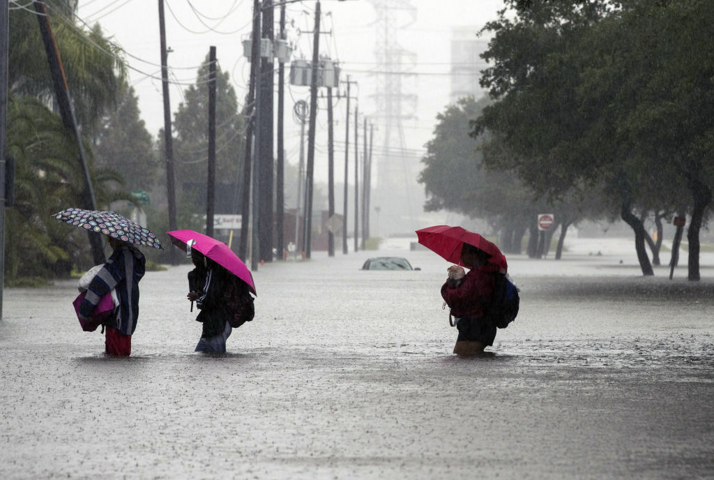 Houston residents attempt to escape to flooding from Hurricane Harvey.