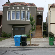 Trash, recycling and compostable material bins sit in front of homes in a Sunset district neighborhood June 11, 2009 in San Francisco, California.