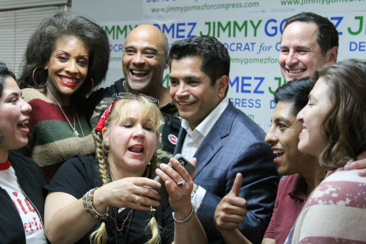 Jimmy Gomez takes a selfie with supporters at his election night celebration on June 6, 2017, in the Eagle Rock community of Los Angeles, California. Just moments after announcing that his opponent called to concede the race.
