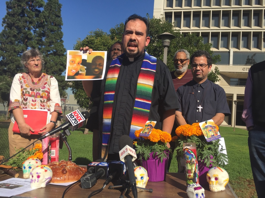 Rev. Francisco Garcia of Holy Faith Episcopal Church led a protest outside Inglewood City Hall over the police killing of Kisha Michael and Marquintan Sandlin in February. (11-02-0-16)