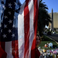 The US flag is left at a makeshift memorial outside the Route 91 music festival site beside the Mandalay Hotel October 4, 2017 on the Las Vegas Strip, after a gunman killed 58 people and wounded more than 500 others when he opened fire from the Mandalay Hotel on a country music festival in Las Vegas, Nevada.