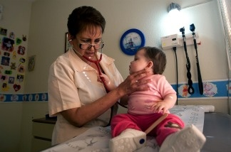Pediatrician Elsa Maldonado examines a child at her office.