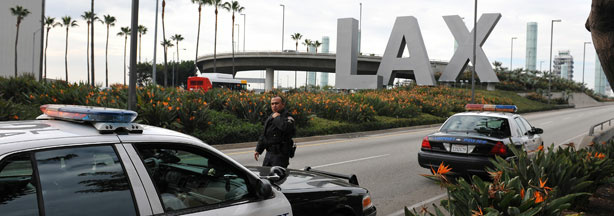 A police officer walks to his patrol car at a security checkpoint near the entrance to Los Angeles International Airport on December 26, 2009.