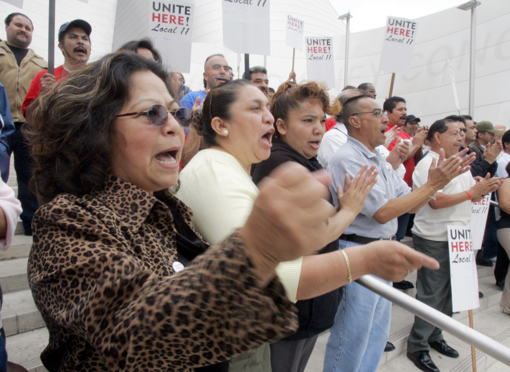 Hotel workers, including Julia Brito, left, a housekeeper at the Westin Bonaventure Hotel, and their supporters celebrate at a rally in downtown Los Angeles in 2005.